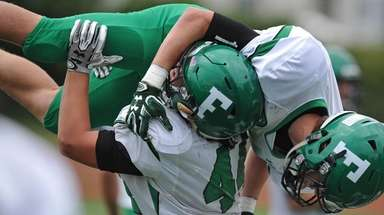 Neil Levantini of Farmingdale hoists Justin Steinheimer into