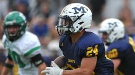 Angelo Petrakis of Massapequa rushes for a gain