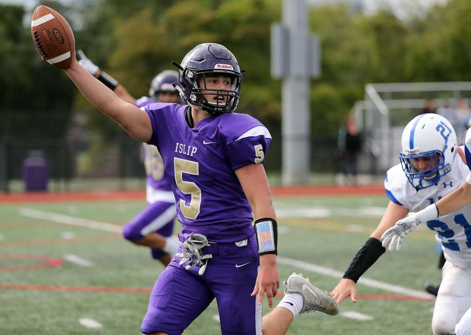 Islip quarterback Joe Juengerkes holds out the ball