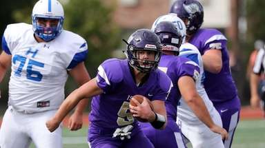 Islip quarterback Joe Juengerkes breaks into the secondary