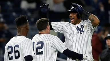 Aaron Hicks #31 of the Yankees celebrates his