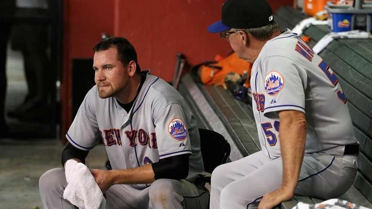 Starting pitcher Mike Pelfrey reacts in the dugout
