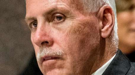 Suffolk County Legis. Kevin McCaffrey listens to colleagues