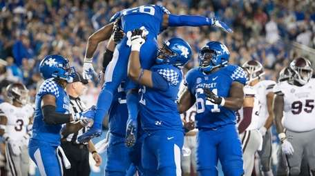 Kentucky running back Benny Snell Jr. is hoisted