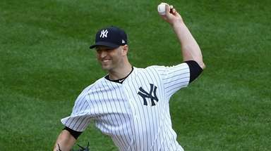 Yankees starting pitcher J.A. Happ delivers against the