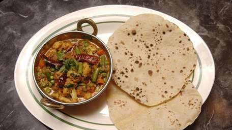 A plate of vegetable Chettinad served at Dosa