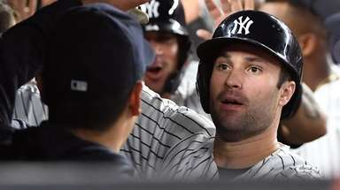 Yankees first baseman Neil Walker is greeted in