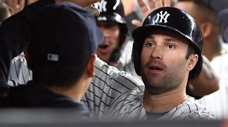 Yankees first baseman Neil Walker is greeted in