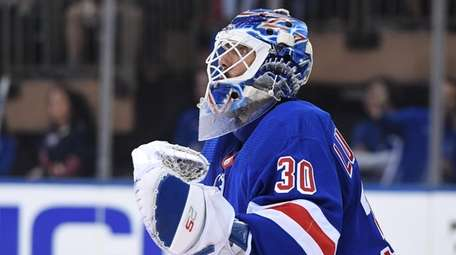 New York Rangers goalie Henrik Lundqvist guards the