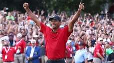 Tiger Woods celebrates making a par on the