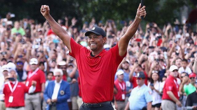 Tiger Woods celebrates making a par on the