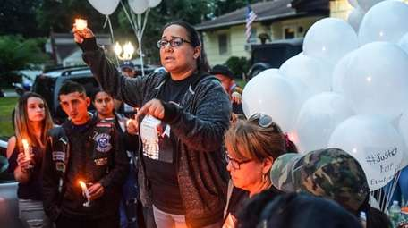 Feride Castillo speaks during a vigil at the