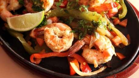 A plate of shrimp fajitas is served at