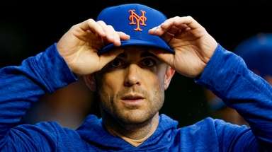 David Wright walks through the Mets' dugout during
