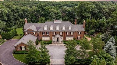 The five-bedroom West Hills home is next to