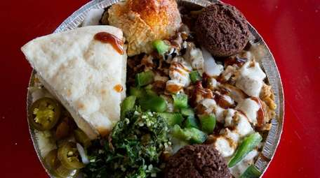 A chicken combo platter with falafel at Halal
