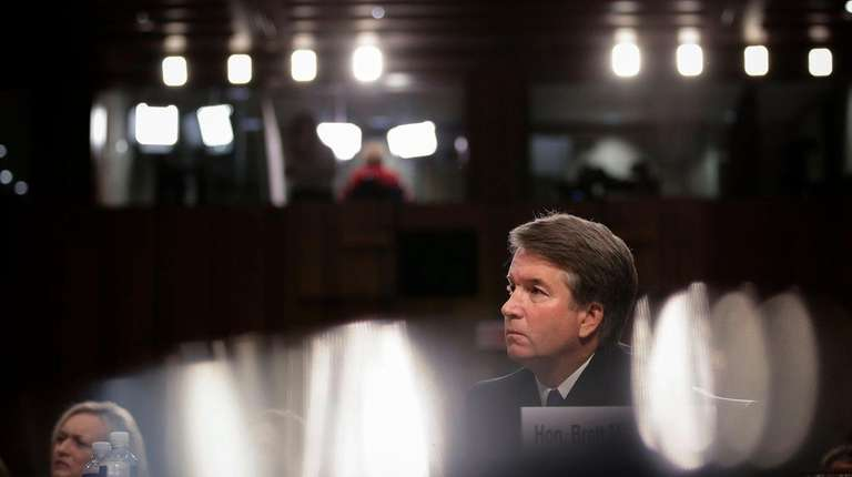 Judge Brett Kavanaugh listens to opening statements during