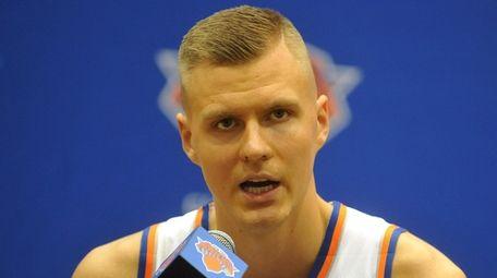 Knicks forward Kristaps Porzingis fields questions during the