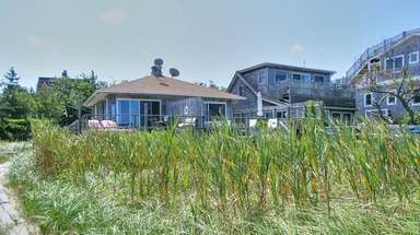 The Cherry Grove waterfront estate includes a two-story,