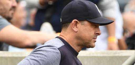 Yankees manager Aaron Boone looks on against the