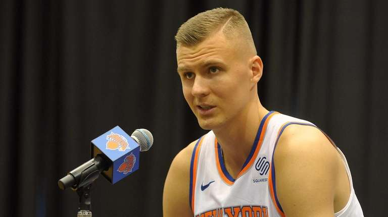 Knicks forward Kristaps Porzingis fields questions during media