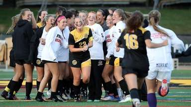 St. Anthony's players celebrate their 2-0 win over