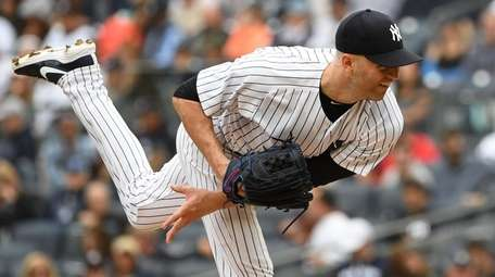 Yankees pitcher J.A. Happ delivers against the Orioles
