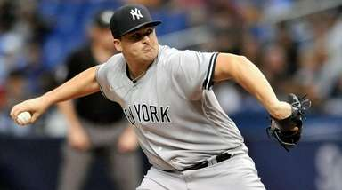 Yankees starting pitcher Jonathan Holder delivers against the