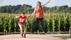 Dean Tristan Belmonte, 10, left, of East Moriches,