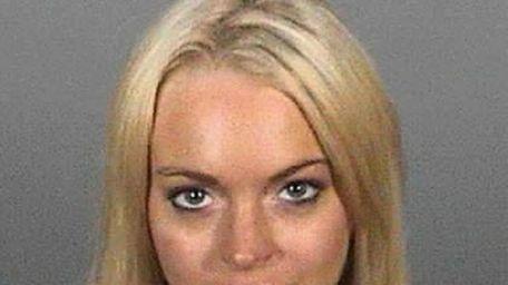Lindsay Lohan in prison garb for mug shot.