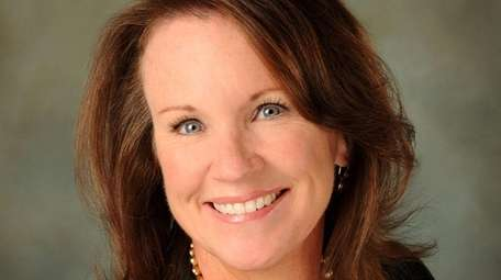 Christine Rice of Garden City has been promoted