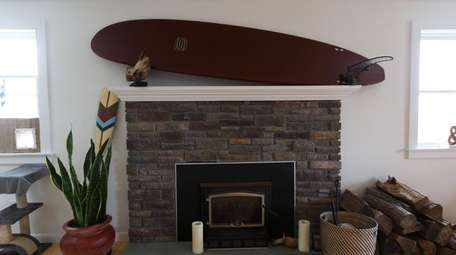 Surfboards decorate Infernuso's house, inside and out.