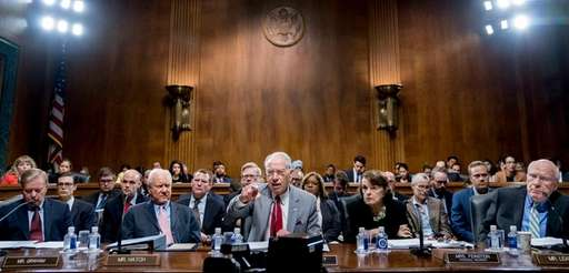 Senate Judiciary Committee chairman Chuck Grassley, center, leads