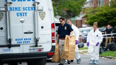 NYPD investigators Friday in Flushing where police say