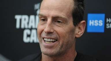 Nets Head Coach Kenny Atkinson speaks with the
