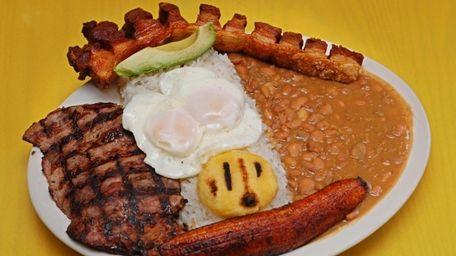 The Tipica platter - steak, fried eggs, rice,