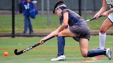 Eastport-South Manor's Kylie Harrison takes the shot against