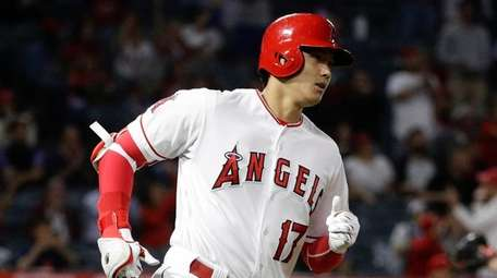 The Angels' Shohei Ohtani rounds the bases after