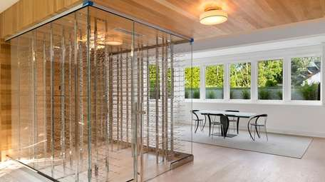 The transparent, climate-controlled wine cellar holds 1,000 bottles