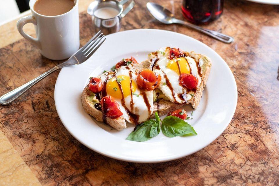 The AvoTomo breakfast plate has mashed avocado atop