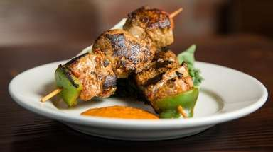 Pinchos morunos (marinated pork skewers) at NoaMar Market