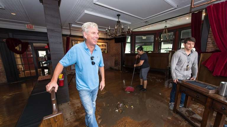 Owner David Tunney, left, finds a moment to