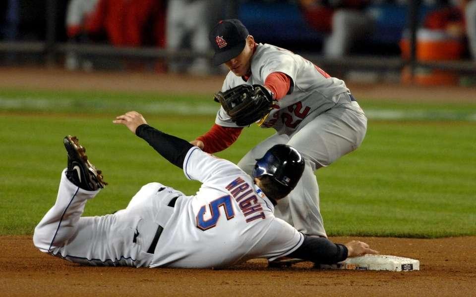 Mets third baseman David Wright slides safely in