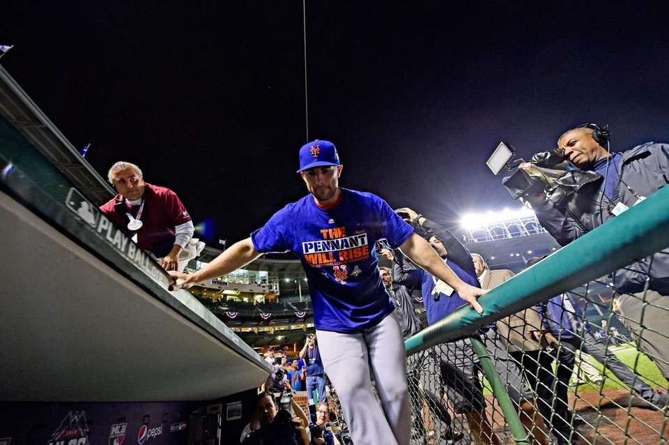 David Wright celebrates on the field after winning