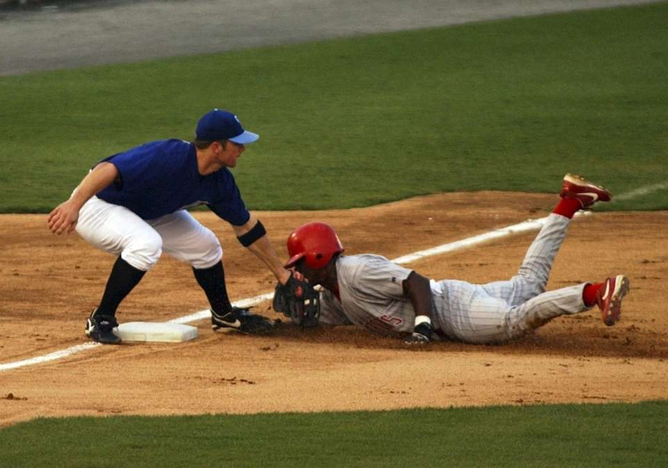 Norfolk Tides third base player David Wright tags