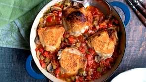 Chicken thighs simmered with tomatoes, mushrooms, bell peppers