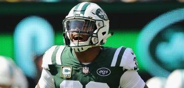 Jets defensive back Jamal Adams celebrates after making