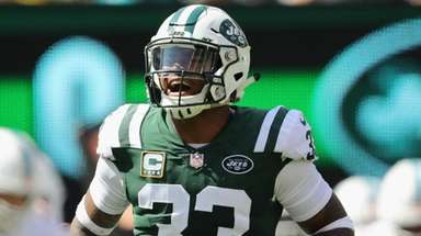Jets defensive back Jamal Adams celebrates after making