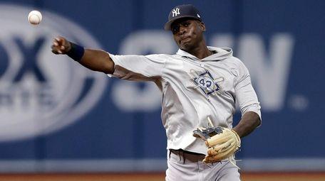 Yankees shortstop Didi Gregorius throws the ball to