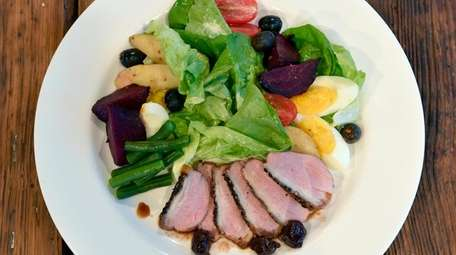 A salad nicoise with rosy-pink duck breast substituted